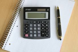 Need 6000 Loan calculator and pen on desk
