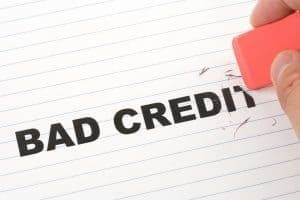 How To Get A Loan With Bad Credit rubbing out bad credit writing on page