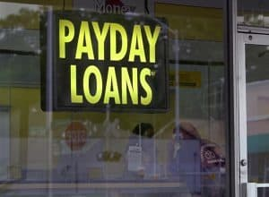 One Hour Payday Loans shop front window sign