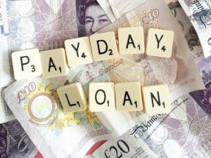 Capital Cash Payday Loans scrabble letters on top of cash notes